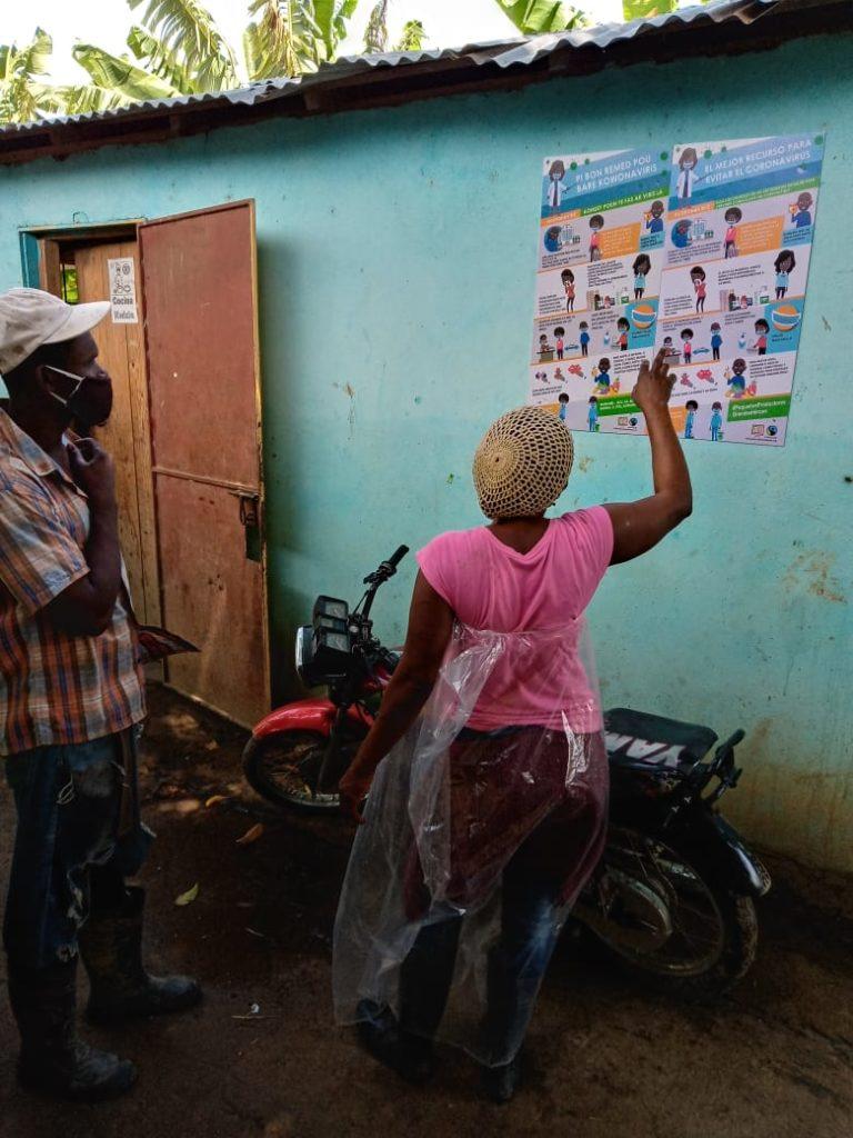 Poster di prevenzione a COVID-19 a Banelino (Repubblica Dominicana